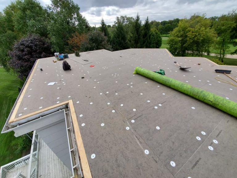 Modern Xterior Flat Roof Residential Installation